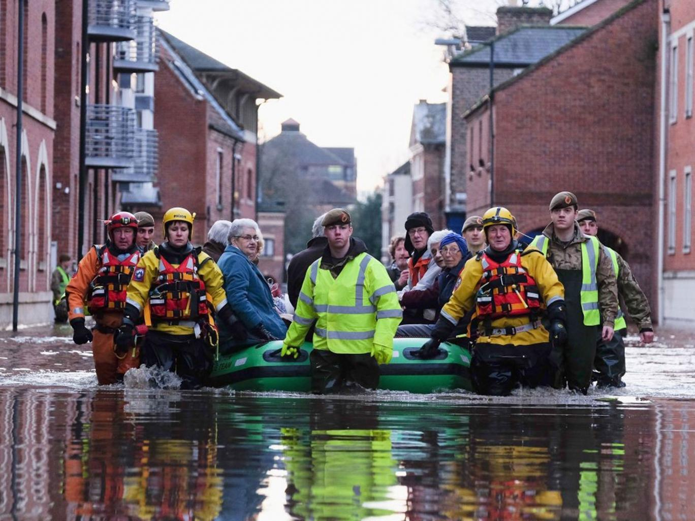 Rescuers using an inflatable boat