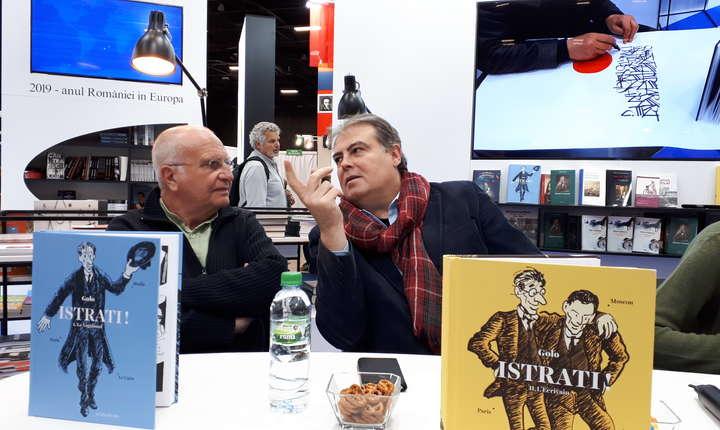 Desenatorul Golo (stânga) si Adrian Cioroianu (dreapta), ambasadorul României pe lângà Unesco, la recentul salon al càrtii de la Paris