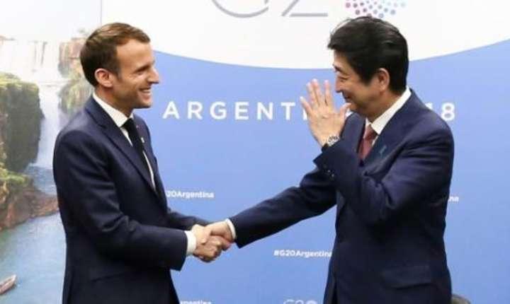Preşedintele francez Emmanuel Macron şi primul ministru japonez Shinzo Abe la reuniunea G20 din Argentina, pe 30 noiembrie  2018.