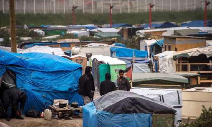 Migranti afgani la Calais, mai 2016