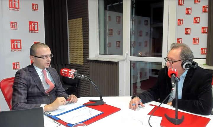 Iancu Guda, preşedintele Asociaţiei Analiştilor Financiari Bancari din România si Constantin Rudnitchi