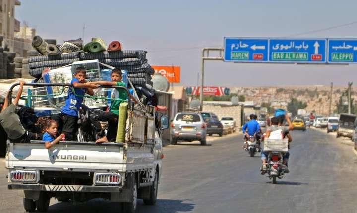 Civili care fug din Idlib pe 6 septembrie 2018 de o probabilà ofensivà contra ultimului bastion al rebelilor sirieni