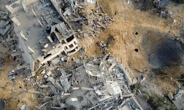Imagine aeriana a unor cladiri distruse în nordul Fâsiei Gaza în urma unor lovituri israeliene, 13 mai 2021.