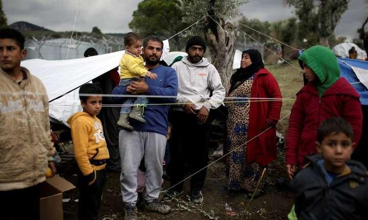 Familie de refugiati sirieni pe insula Lesbos, Grecia, 30 noiembrie 2017