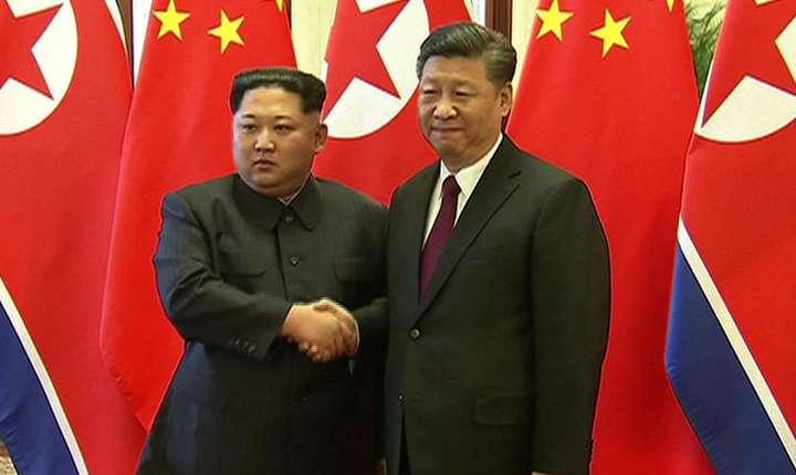 Kim Jong-un şi Xi Jinping (Foto: CCTV/AFP)