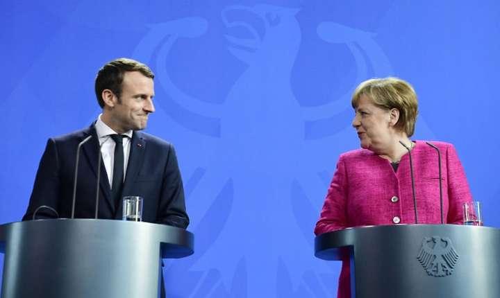 Emmanuel Macron si Angela Merkel în cursul unei conferinte de presa comune