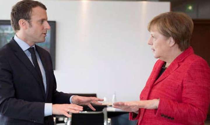 Emmanuel Macron, noul presedinte al Frantei, este primit de cancelara germanà Angela Merkel (foto arhivà)