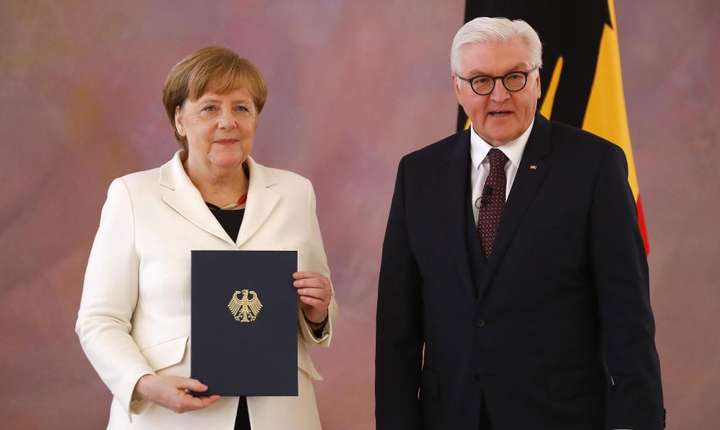 Angela Merkel si presedintele Germaniei Frank-Walter Steinmeier, la ceremonia de reinstalare în functie a cancelarei, 14 martie, Berlin