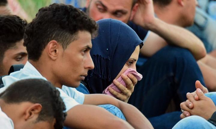 Migranti la frontiera sârbo-maghiarà, lângà Rozske, septembrie 2015