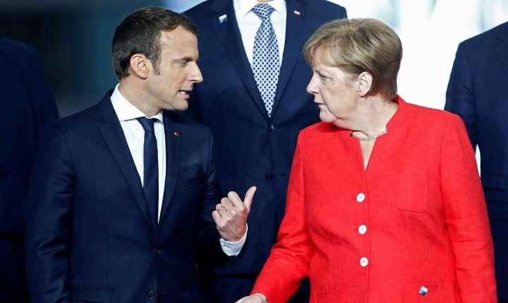 Emmanuel Macron si Angela Merkel cu prilejul unei precedente întîlniri, în mai 2017