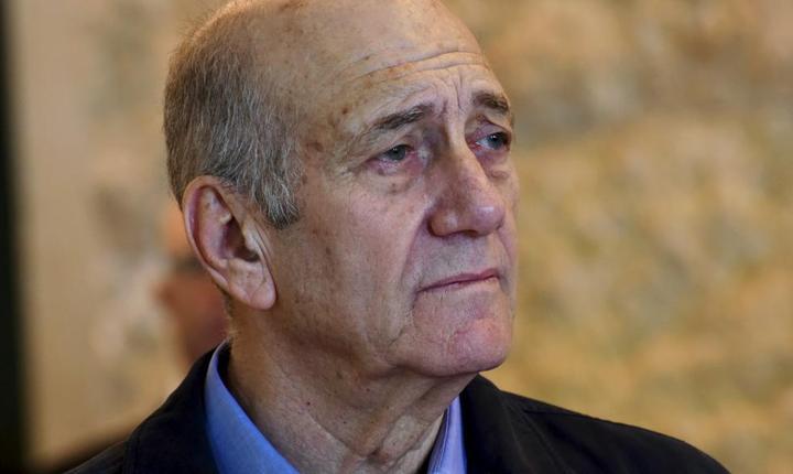 Ex-premierul israelian Ehud Olmert la aflarea condamnàrii sale la 19 luni închisoare
