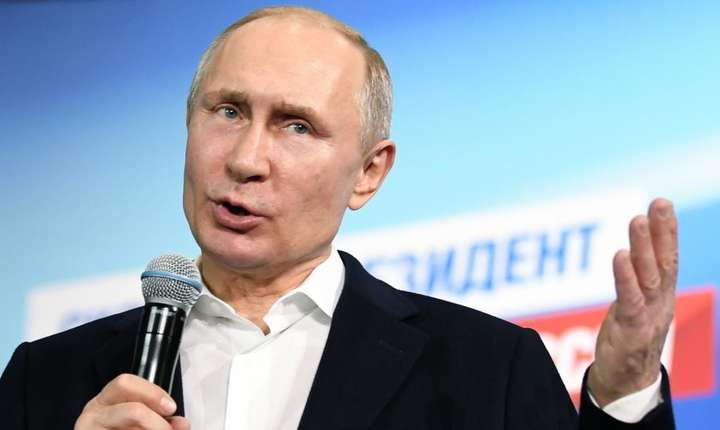 Vladimir Putin, presedintele Rusiei, în fata fanilor sài de la Moscova, 18 martie 2018
