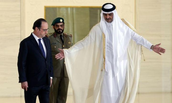 Presedintele Frantei François Hollande primit ieri în Qatar (Foto Reuters/Christophe Ena)