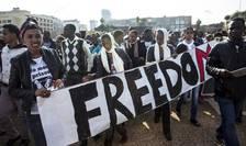 Migranti africani manifestînd la Tel Aviv în ianuarie 2014