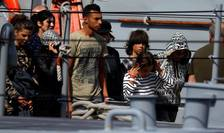 Migranţi salvaţi în Mediterana, debarcaţi pe 30 septembrie 2018 în portul La Valetta.