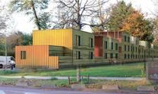 200 de migranti sau oameni fàrà adàpost ar urma sà fie cazati lângà Bois de Boulogne, în constructii prefabricate, timp de trei ani