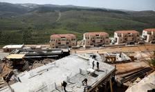 Santier de constructii de locuinte pentru coloni israelieni la Beitar Illit, în Cisjordania, pe 7 aprilie 2019.