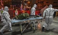 Un nou pacient ajunge la spitalul Crucii-Rosii din Wuhan, 25 ianuarie 2020