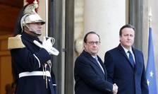 Preşedintele francez, François Hollande şi premierul britanic, David Cameron, la Paris (Foto: Reuters/Eric Gaillard)