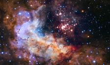 Grup de stele tinere, surprins de telescopul spaţial Hubble (sursa foto: site NASA)