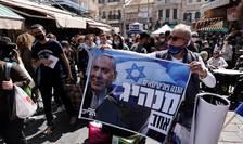 Militant pro-Netaniahu la Mahane Yehuda, Israel.