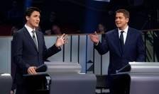 Seful liberalilor - Justin Trudeanu (47 de ani) si principalul sau rival, liderul conservatorilor Andrew Sheer (40 de ani), 10 octombrie 2019, la prima dezbatere pentru legislativele canadiene.