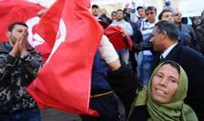 Tunisienii celebreazà o lunà de la ràsturnarea de la putere a presedintelui Ben Ali, 14 februarie 2011
