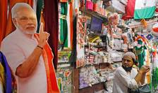 Un poster cu Narendra Modi poate fi vazut într-un magazin din Delhi specializat în vânzarea de materiale electorale.