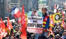 Un sindicalist de la CGT fotografiat în Paris, marti, 5 februarie 2019.
