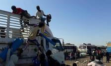 Locuitori ai regiunii Tigray în exod spre Sudan.