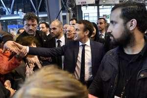 Alexandre Benalla în prim plan, în cursul unei vizite a presedintelui Macron la Salonul agriculturii, 1 martie 2018