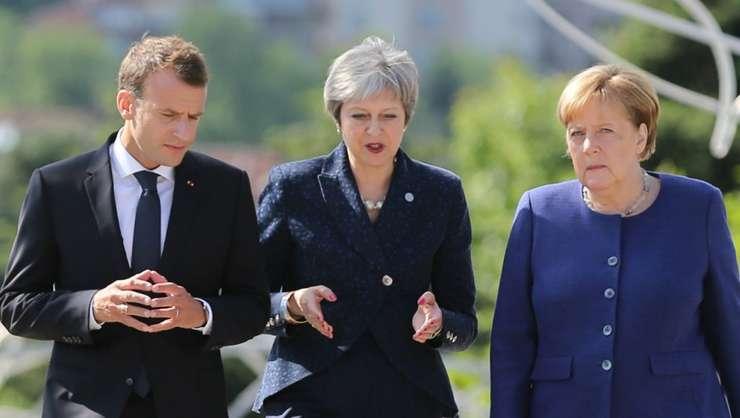 Theresa May căutînd sprijinul lui Emmanuel Macron şi al Angelei Merkel pentru o nouă amînare