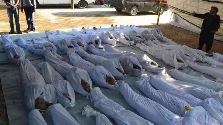 Corpuri de civili probabil ucisi de arme chimice în Guta orientalà (periferia Damascului), 21 august 2013.