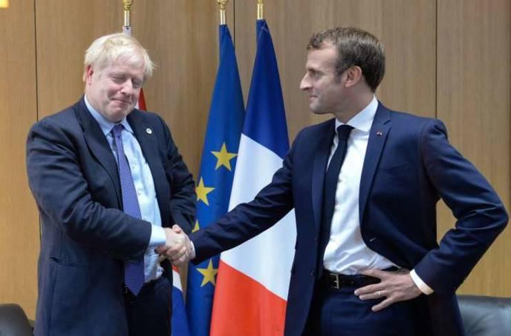 Premierul britanic Boris Johnson si presedintele francez Emmanuel Macron, în marginea unui Consiliu european, Bruxelles, octombrie 2019.