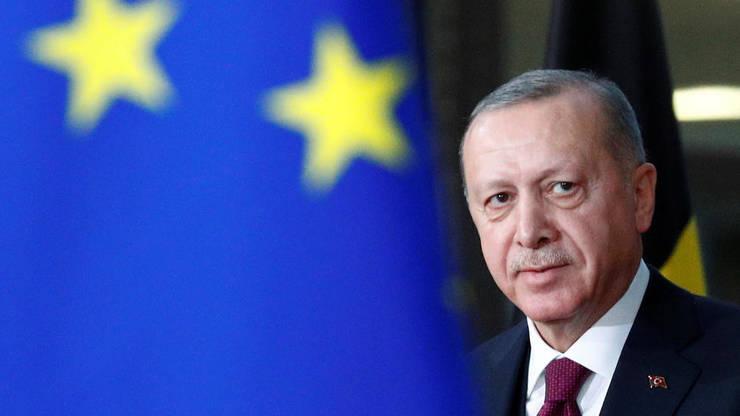 Presedintele turc Recep Tayyip Erdogan în timpul unei reuniuni cu presedintele CE Charles Michels, la Bruxelles, 9 martie 2020.