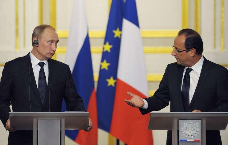 Presedintii rus si francez, Vladimir Putin si François Hollande, la Elysée în 2012