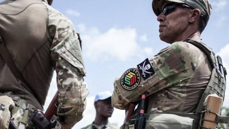Rusi în garda presedintelui RCA, Faustin Archange Touadera, la Berengo, august 2018.