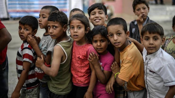 Copii sirieni într-o tabara de refugiaţi din Turcia, iunie 2015