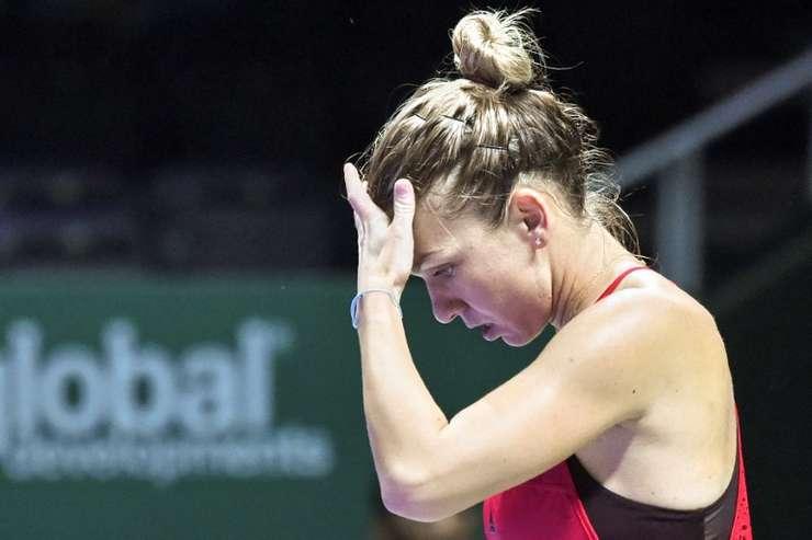 Simona Halep, eliminată la Turneul Campioanelor (Foto: AFP/Roslan Rahman)