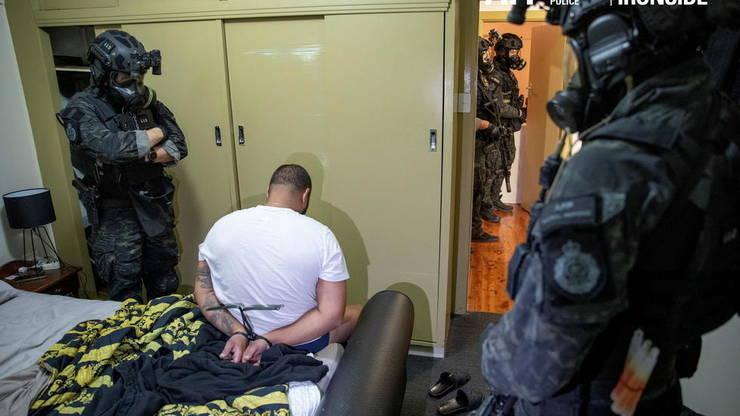 """Un suspect este arestat în Australia în cadrul operatiunii """"Scutul troian""""."""