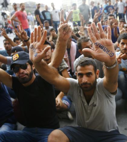 Cei mai mulţi imigranţi vor să ajungă în Germania